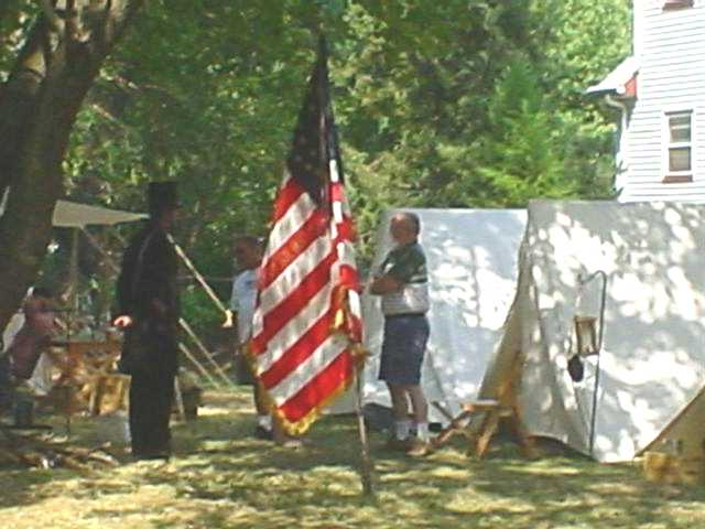 President Abraham Lincoln speaks with a soldier during the reenactment at Buckelew Day.