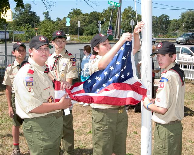 Boy Scouts raise the flag over Buckelew Park