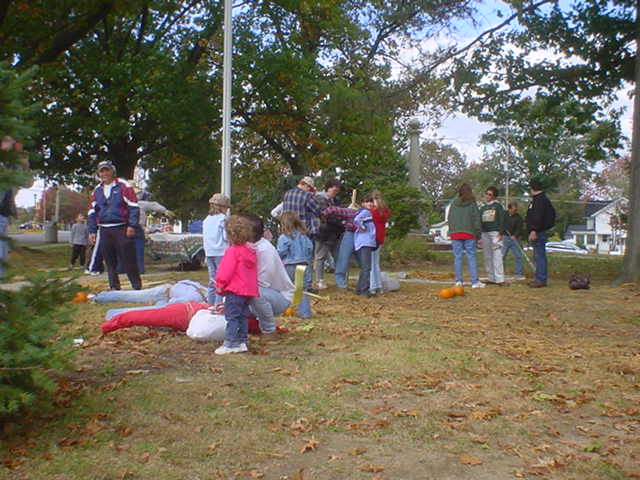 Making scarecrows in Veterans' Memorial Park
