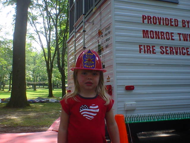 A Young Girl in a Fire Hat