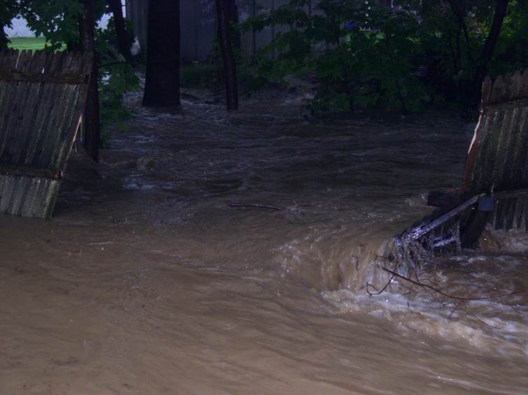 A flood of water rushing in a backyard off Pergola Avenue