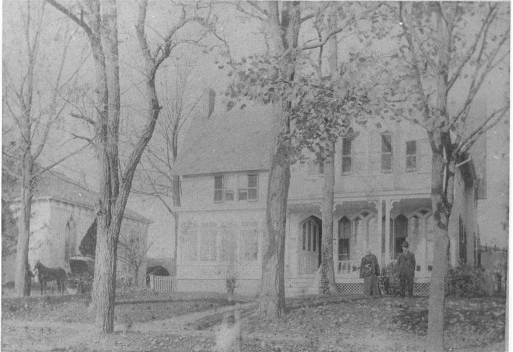 1890 View of the Manse with Dr. and Mrs. B. S. Everitt.