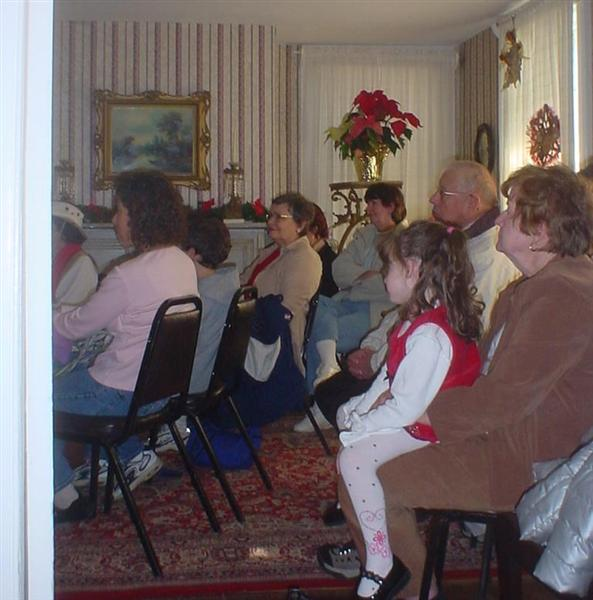 The audience in the front parlor.